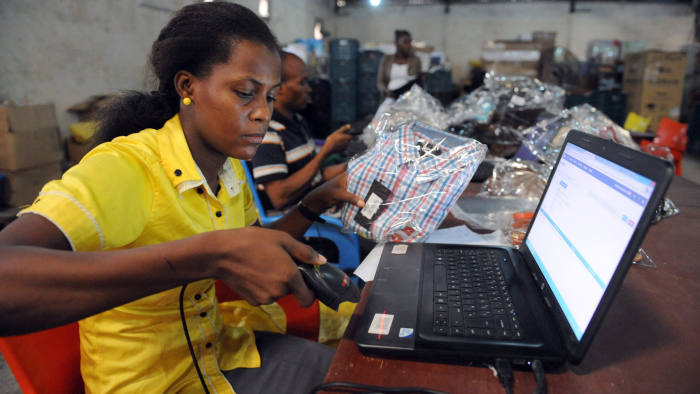 A Jumia worker scans a product at a warehouse in Lagos © AFP